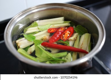Ingredients for TomYam spicy soup in a cooking pot.