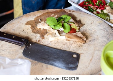 Ingredients of TomYam spicy soup with knife on wooden cutting board.