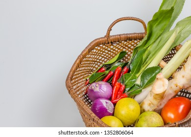 ingredients of TomYam spicy soup put in the basket put on white background.