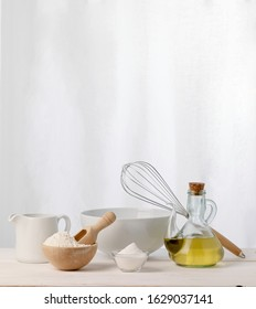 ingredients and tools to make a cake without eggs and butter