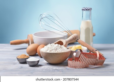 ingredients and tools to make cookies, flour, butter, sugar,egg, milk