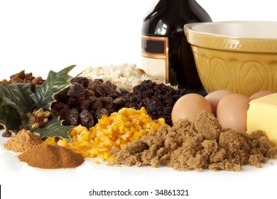 Ingredients for a traditional Christmas pudding, ready for mixing.  Delicious dried fruits and mixed orange and lemon peel, spices, eggs, butter, brown sugar, bread crumbs, and of course brandy.
