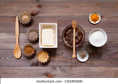 Ingredients for traditional sweets on the rustic wooden table, top view