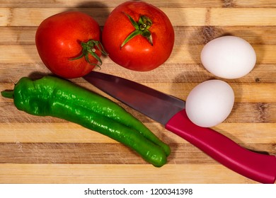 Ingredients for Turkish food Menemen: Tomato, pepper and eggs