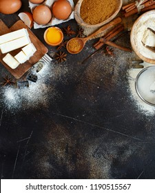 Ingredients and utensils for baking cookies on a dark background