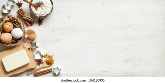 Ingredients and utensils for baking on a wooden background