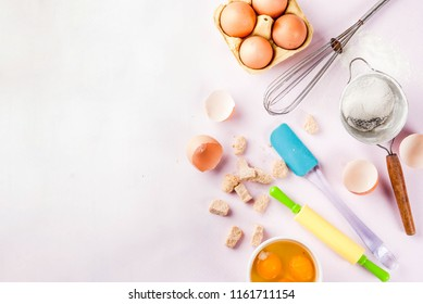 Ingredients and utensils for cooking baking egg, flour, sugar, whisk, rolling pin, on light pink background, copy space top view