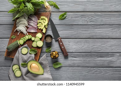 Ingredients for vegetable salad on wooden background