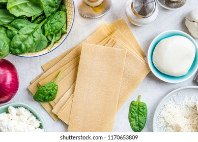 Ingredients for Vegetarian Spinach and Ricotta Lasagna, top view, grey background