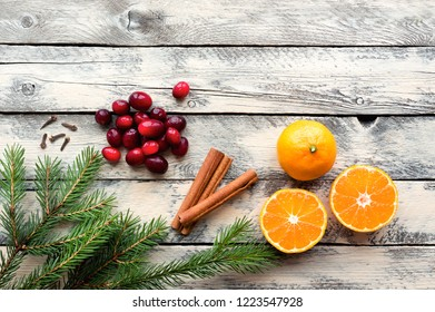 Ingredients for winter drinks. Holiday concept. Decorated with fir branches, cranberries and spices. Top View. Copy space.