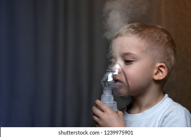 Inhalation child infant under five year. Boy making inhalation with nebulizer at home;