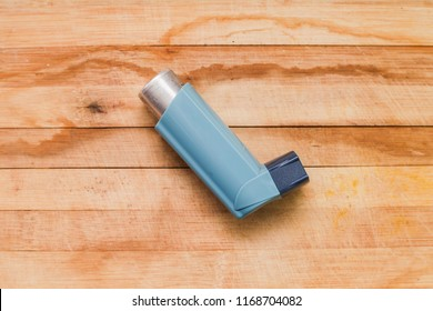 Inhaler on wooden background