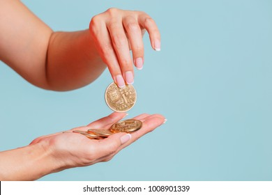 Initial Coin Offering and Token Sale concept.The woman  holds a gold crypto coins in hands.