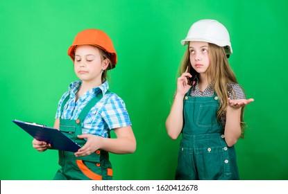 Initiative children girls provide renovation their room green background. Renovation plan. Home improvement activities. Builder engineer architect. Future profession. Kids girls planning renovation.