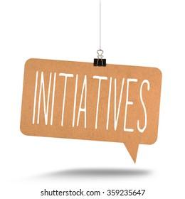 initiatives word on cardboard