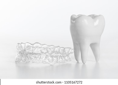Inivisalign braces or aligner. A way to have a beautiful smile and white teeth.
