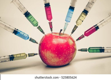 Injecting chemical to apple - gmo fruit