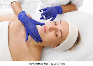 Injecting with hyaluronic acid. A patient in a cosmetic clinic, a beautician performs an injection procedure.