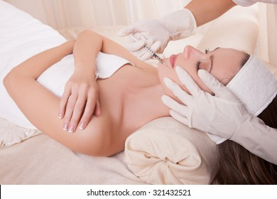 Injection Face, professional face Skin Care Women in the Cosmetic salon. Facial and neck care, ideal dosage of the drug