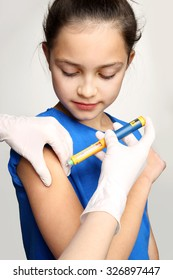 Injection of insulin, a child with diabetes. Girl with diabetes during the injections of insulin.
