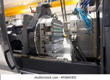 Injection molding machines in a large factory. Department of Italian industry specialized in the manufacture of plastic components: injection moulding machines