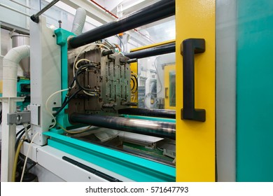 Injection moulding machine used for the forming of plastic parts using plastic resin and polymers