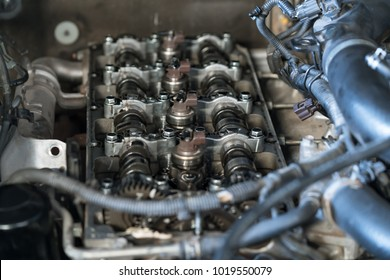 Injection system on modern common-rail turbo diesel engine, camshafts, valve cover at automobile car engine maintenance repair work.