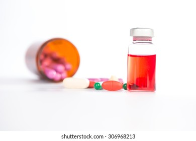 Injection vials and medicine tablet on white
