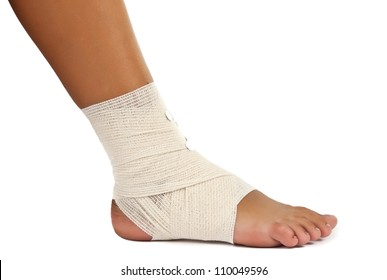 injured ankle with bandage on a white background