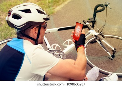 Injured biker holding his smartphone calling rescue team with simple user-friendly smart phone application