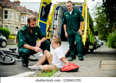 Injured boy getting help from paramedics