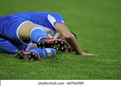 Injured football player on field