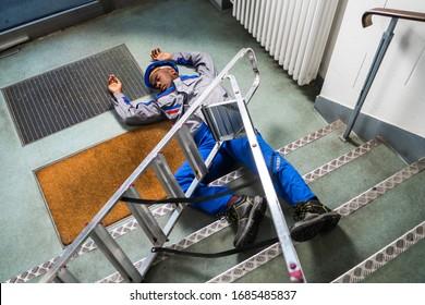 Injured Handyman Fallen From Ladder Lying On Floor