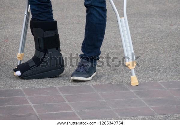 Injured Man Broken Foot Using Crutches Stock Photo (Edit Now