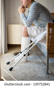 Injured Man in deep thoughts with a leg plaster