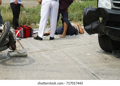 Injured man getting emergency help after accident on the road