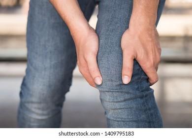injured man suffered from knee joint pain, osteoarthritis