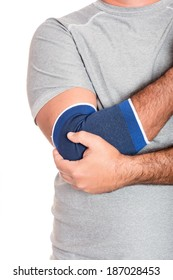 Injured, pain - Man with a therapeutic elastic band on his elbow isolated on white