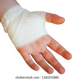 Injured painful hand with white gauze bandage on white background