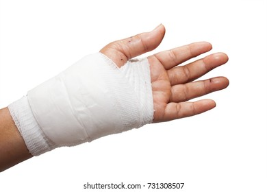 Injured painful hand with white gauze bandage. on white background