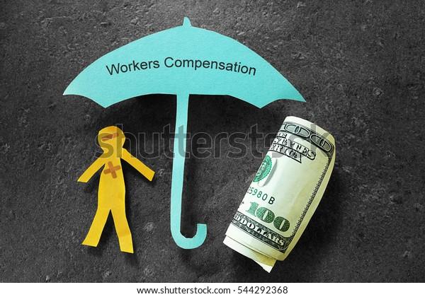 Injured paper man with money, under Workers Compensation umbrella