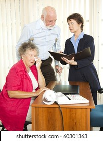 Injured senior man and his upset wife meet with a personal injury lawyer.