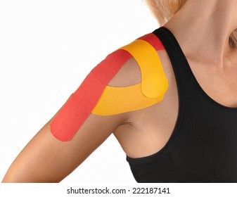 Injured shoulder therapy with kinesio tex tape.