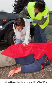 Injured woman and dead body after a car accident