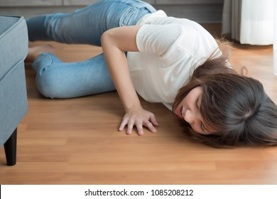 injured woman falls down due to slippery floor; portrait of asian woman falling down, breaking her back, leg, knee, arm, hand bone due to slippery floor accident, 30s adult asian chinese woman model