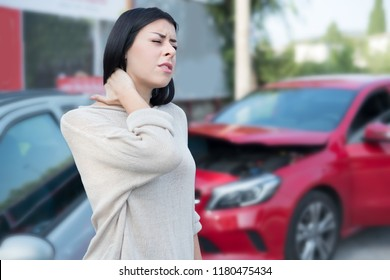 Injured woman feeling neck pain after car crash