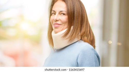 Injured woman wearing neck brace collar confident and happy with a big natural smile inviting to enter