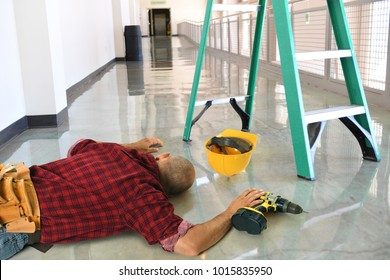 Injured worker laying on floor after fall