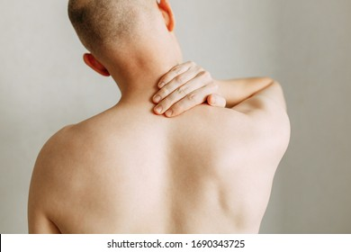 Injuries to the spine and lower back, fatigue at work. Area of the injury, the image on a clean background. Spasm on the man's back.