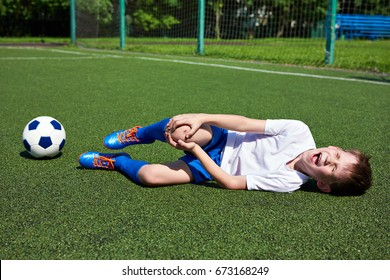 Injury of the knee in the boy football soccer player